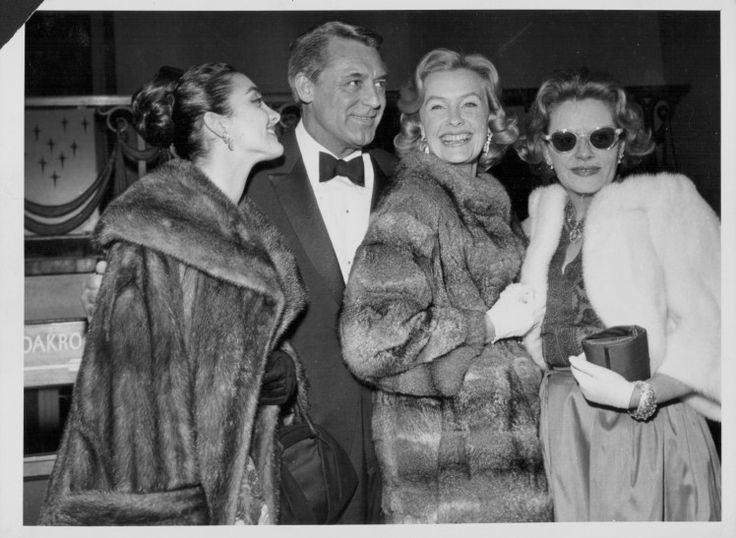 Cary Grant with author Fleur Cowles (right) and actresses Kamala Devi (left) and Dina Merrill at the premiere of the film 'Operation Petticoat', London, January 29th 1960. (Photo by Keystone/Hulton Archive/Getty Images)