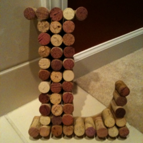 DIY success! Purchase wooden letter at a craft store, collect corks, start hot gluing!