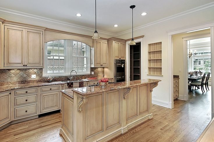 Traditional Kitchen with Stone Tile, Pendant Light, African Ivory Granite Countertop, Inset cabinets, Limestone Tile