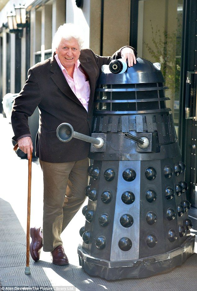 New friends: Tom Baker posed with a Dalek outside the Ivy Club in London on Monday at a Doctor Who launch