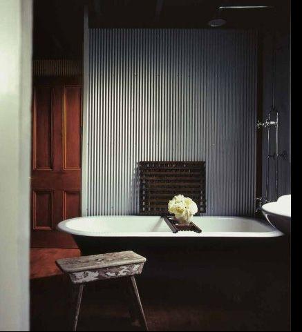 Looks like (small rib) corrugated aluminum/galvanized steel panel on wall??