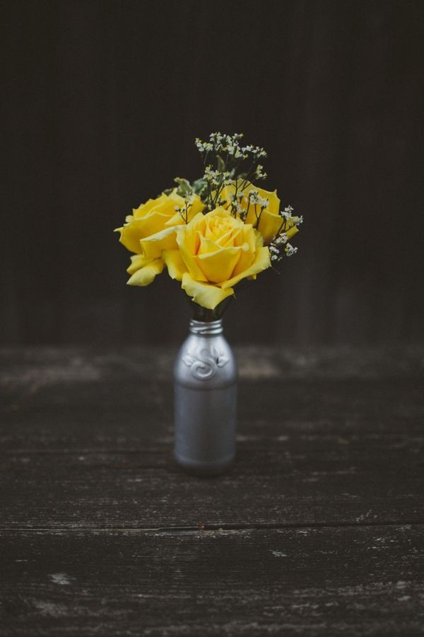 DIY Spray painted bottles as vases with yellow roses