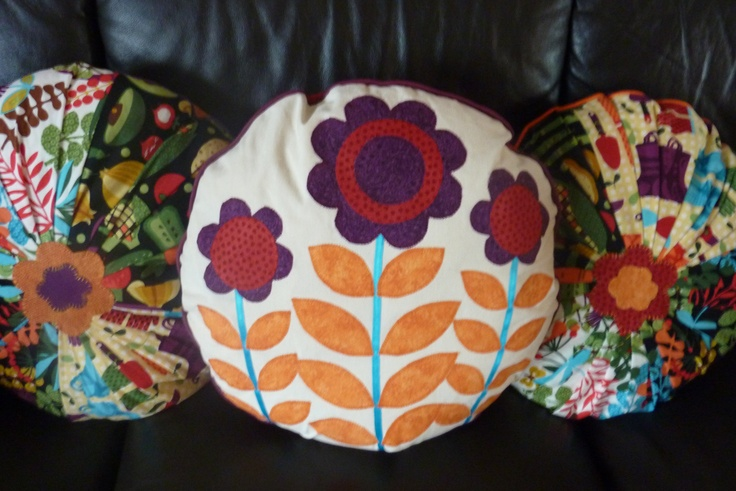 Vibrant cushions, pleated and appliqued. Flower design from a Simplicity pattern.