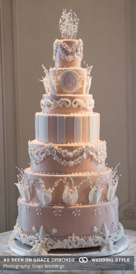 Seven-tiered fondant wedding cake with sugar paste ivory details and lily of the valley