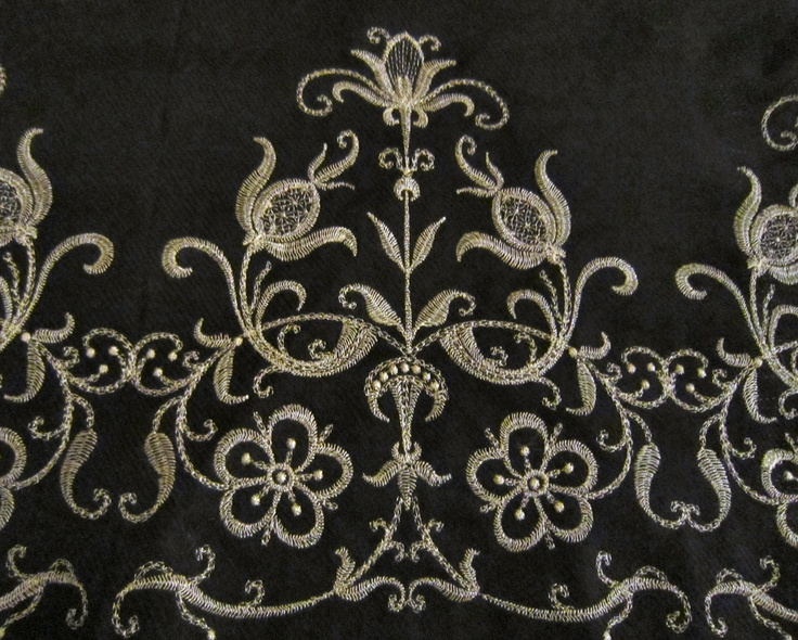Baroque embroidery done with gold metallic thread