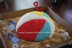 I made this Beach Ball Cake Idea for my son's 2nd Birthday. He was very into all sorts of balls this year, and since it falls in summer it was a perfect