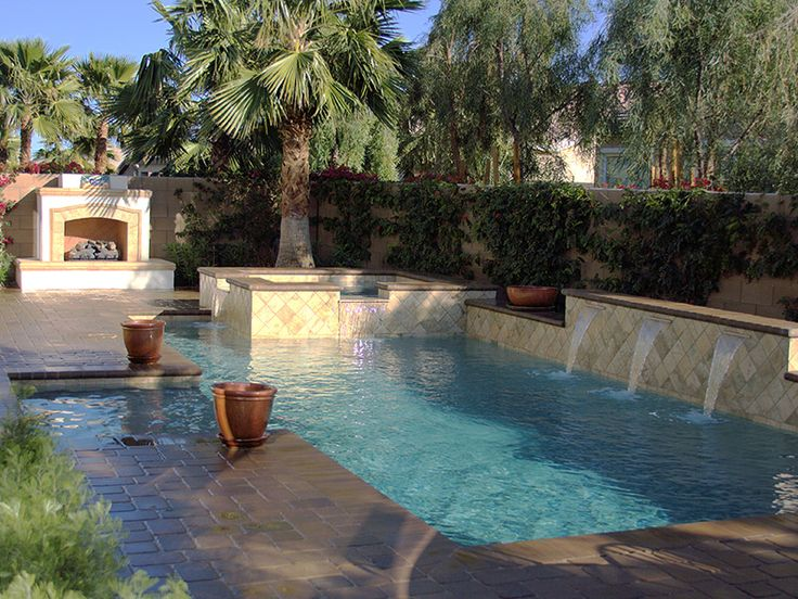 Spanish tile pool with fireplace and spa pool for Backyard makeover with pool