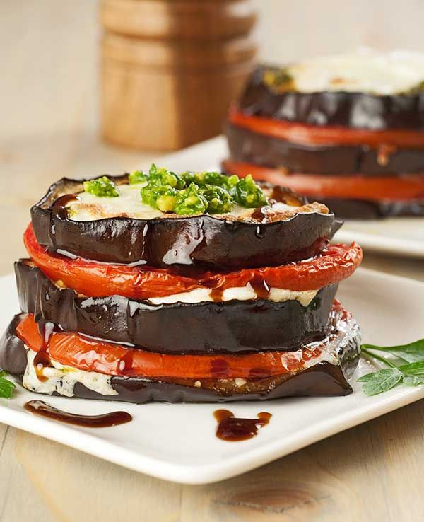 Eggplant, Tomato and Pesto Napoleons: Served with a side of pasta and a green salad these tasty rounds of roasted eggplant layered with fresh basil pesto, tomatoes and mozzarella cheese make a great meatless meal.