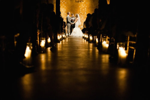 Weddingish Advice: have your wedding ceremony lit up only at the alter and the rest of the ceremony area dimmed down and illuminated with candles. this adds a nice theatrical touch to your ceremony and makes it more intimate.