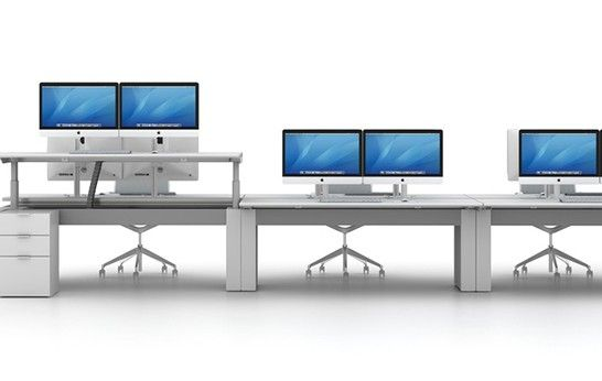 Double computer screens are becoming more and more common in corporate work environments.  #Corporate #InteriorDesign