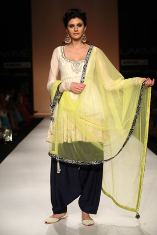Cream silk mul cropped anarkali with zardosi embroidery worn with cotton silk navy salwar and lime tulle dupatta. SHOP THE LOOK: http://www.payalsinghal.com/off-the-runway/sanam-anarkali