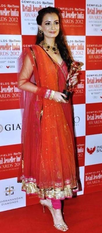 Dia Mirza on red carpet in luscious orange/pink/red kameez