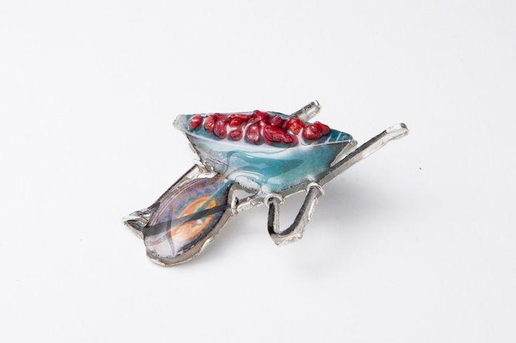 """Wheelbarrow of full of rubies"" Brooch (Sterling silver, resin, small rock, photo paper)"