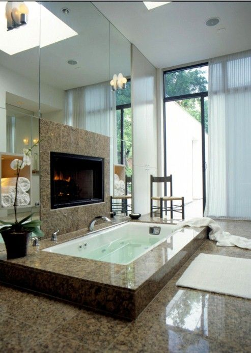 in 2nd bathroom off 2nd bedroom or guest room.  (If nobody was using that bedroom, I would use this bath sometimes!) Again, love the fireplace and where the towels are would be heated.