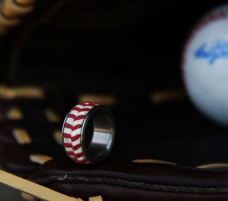 Baseball wedding band. Handcrafted ring made from the leather and stitching of a official league baseball. Handcrafted by Staghead Designs.