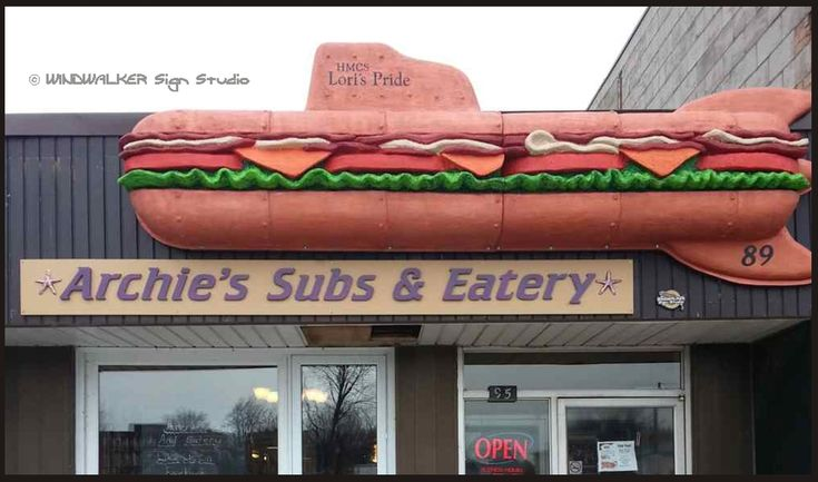 A 13 foot long submarine / sub sandwich 3d carved by Windwalker Sign Studio