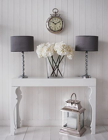 Chrome and grey table lamp shown as a pair on the gloss white console table for a striking centre piece.