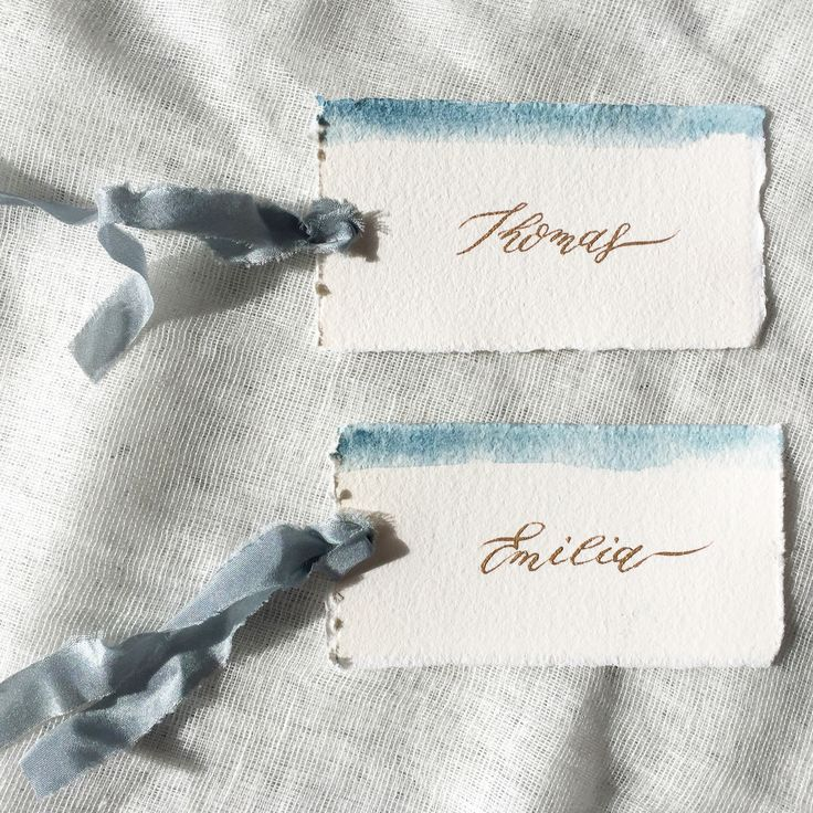 Dusky blue watercolour and gold calligraphy place cards/ escort card on hand made paper and silk ribbons