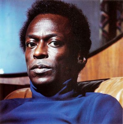 Miles Davis in a turtleneck in an Eames chair - beautiful beautiful genius music - gorgeous man