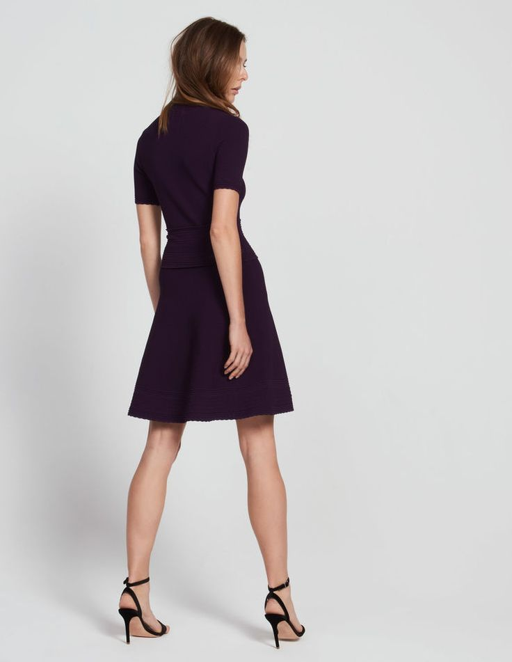 Sandro dress<br /> • V-neck and short sleeves <br /> • Elasticated knit <br /> • Textured stitching detail <br /> • Waist accentuated with a set of bands with notched details<br /> • Notched details on the sleeves, neckline and hem<br /> • Flared hem <br /> • Model is wearing a size 1<br /><br />