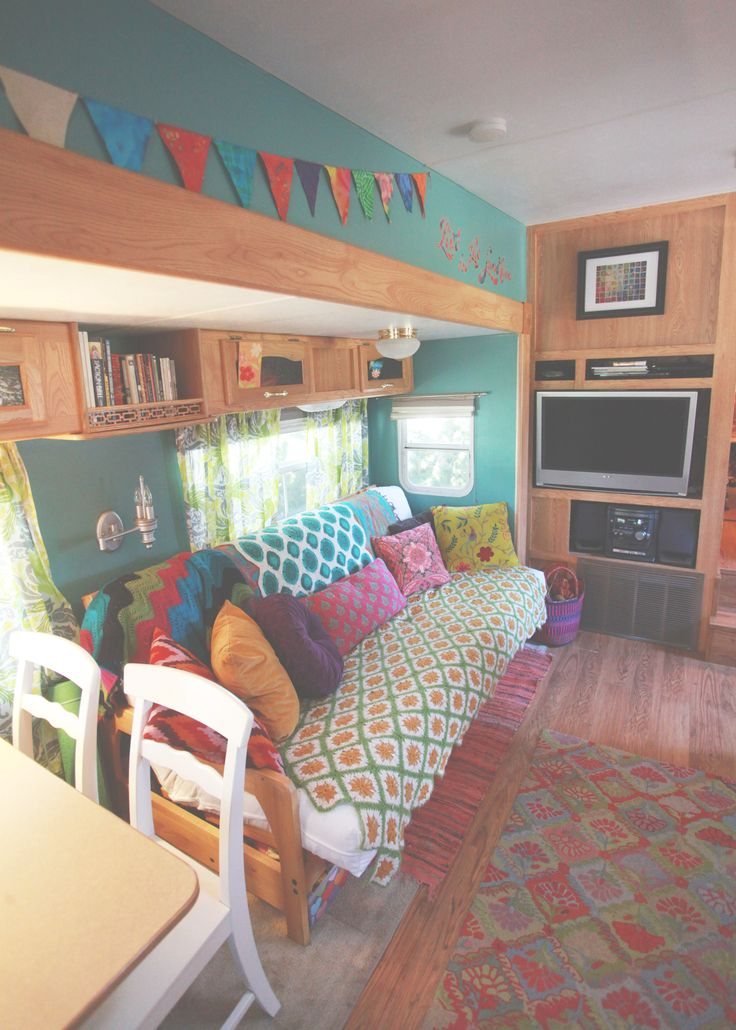 Definitely NOT your grandma's RV. This is a super-vamped 2003 Keystone Laredo. Love the bold mix of patterns and colors. More proof that color is to be embraced, not feared!