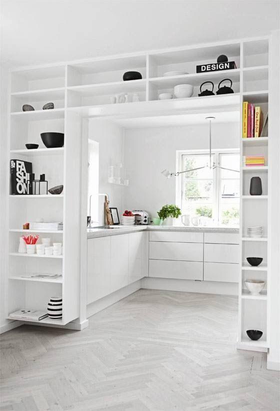 kitchen entry framed by shelves.