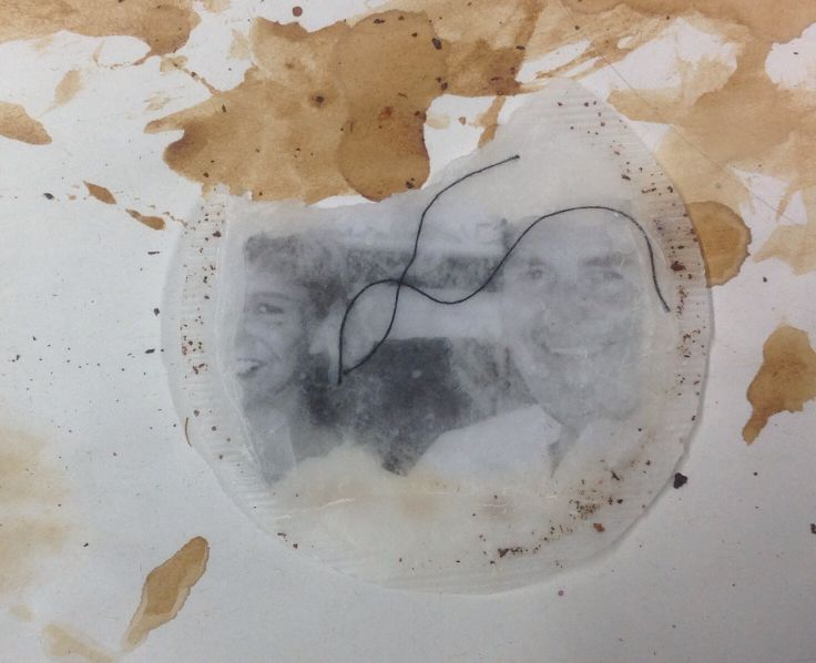 Tea bag dipped in wax, trapped photocopy with thread