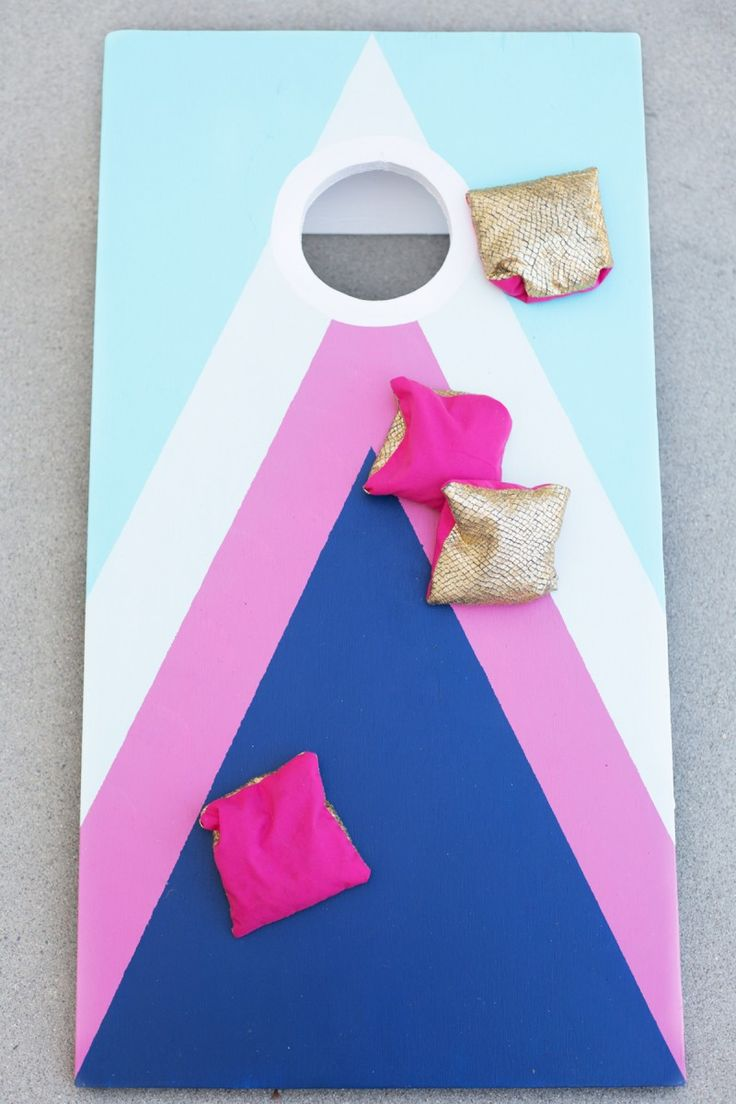 Here's a perfect DIY project for some backyard summer fun - a cornhole game!