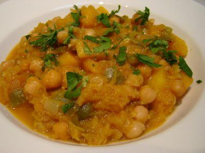 Pumpkin & Chickpea Stew 100g chickpeas, soaked overnight ( or 400g can chickpeas) 1 large onion, peeled & quartered 1/2 capsicum (preferably red), diced 2 Tbsp oil 500g butternut pumpkin, peeled and cut into 1cm cubes 2 tsp ground cumin 2 tsp ground coriander 1 tsp sweet paprika 1 Tbsp tomato paste 300g vegetable or chicken stock salt & pepper fresh coriander to garnish