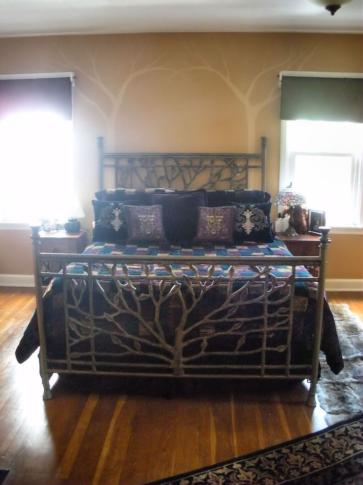 """Our very own """"tree bed"""" in our fairy tale forest bedroom, with 'Windling Trees' on the walls."""