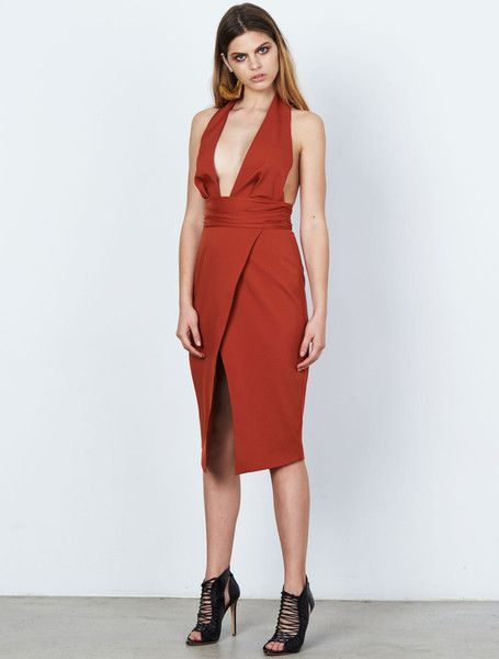 ISLA RESOURCE MIDI DRESS from the Stardust Collection. Take the plunge in this on-trend tobacco coloured midi dress. This sexy halterneck style has a plunging neckline and flattering wrap effect skirt, with a gathered banded waist to really hone that hourglass silhouette. Fully lined, with a concealed rear zip. Available: www.islalabel.com #islalabel #fashion #style #winter #dress #mididress #halterneck #tobacco #asymmetric