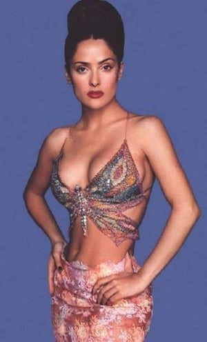 """Photos of Salma Hayek, one of the hottest girls in movies and TV. There are few women out there as sexy and talented as Salma Hayek. Hot - or should I say Caliente - is her middle name. Fans will also enjoy sexy bikini pics of Salma Hayek and the hottest photos of her famous """"assets.&quo..."""