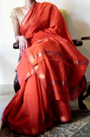 Style up your wardrobe with this beautiful rust and gold handloom cotton silk Maheshwari saree. Its lovely texture will make it a pleasure to wear, and the beautiful, translucent fabric will make you look even more feminine. Blouse piece is attached to the sari. - See more at: http://www.giftpiper.com/HandloomMaheshwariSaree-Rust-id-421934.html