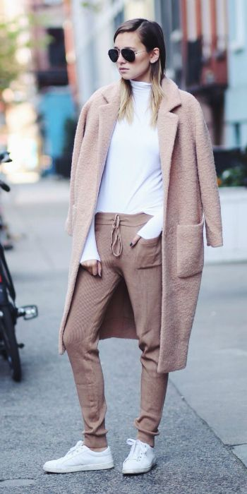 Danielle Bernstein + casual + pair of nude joggers + matching overcoat + plain white t-shirt + sneakers + shades + spring/summer must have. Coat: Ganni, Trousers: Zara, Top: Vince.
