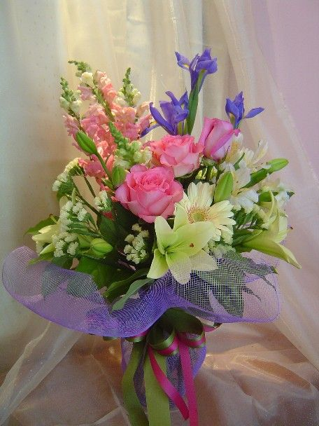 **Love the opened roses.**Roses, gerbera, lillies, iris, snapdragon, statice, and alstroemeria