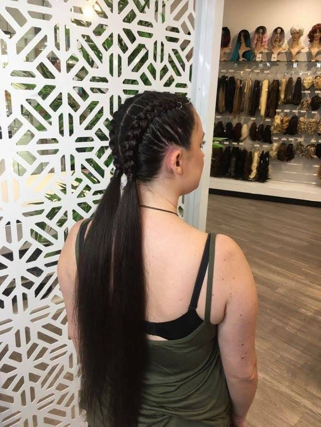 Two Dutch Braids On Long Hair With The Ends Left Out As Piggytails