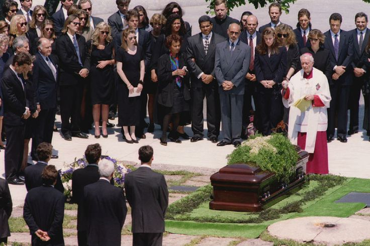 JACQUELINE KENNEDY ONASSIS DIES ON MAY 19, 1994. Archbishop Philip Hannan, right, presides over the funeral of former First Lady Jacqueline Kennedy Onassis at Arlington National Cemetery on May 23, 1994. She was laid to rest next to her first husband.