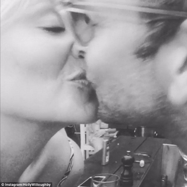 Sealed with a kiss: Holly Willoughby proved she was as loved-up as ever with her husband Dan Baldwin as she shared a romantic video of the pair kissing on Instagram on Thursday, captioned with a heart