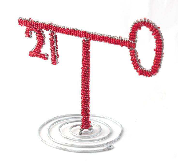 Wire beaded Key on a beaded stand.