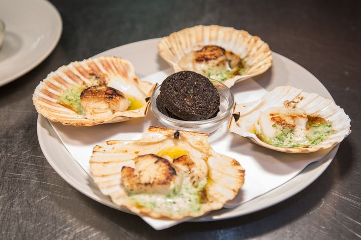 Slices of Stornoway Black Pudding and cooked scallops with garlic butter. Loch Fyne Restaurant & Oyster Bar.  http://www.visitscotland.com/info/food-drink/loch-fyne-oyster-bar-p312911