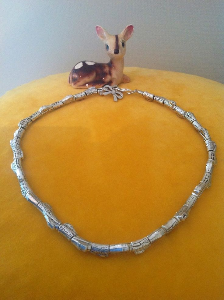 Simple but effective necklace made form pewter log-shaped beads and finished with a cute bow at the clasp. Length approx 45cm.