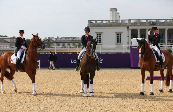 Charlotte Dujardin Photos Photos - Gold medallist Charlotte Dujardin (C) of Great Britain riding Valegro, silver medallist Adelinde Cornelissen (L) of Netherlands riding Parzival and Laura Bechtolsheimer of Great Britain riding Mistral Hojris celebrate with their medals during the medal ceremony following the Individual Dressage on Day 13 of the London 2012 Olympic Games at Greenwich Park on August 9, 2012 in London, England. - Olympics Day 13 - Equestrian
