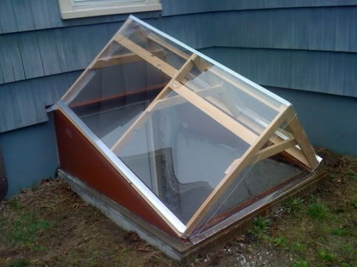 turn a cellar door into a greenhouse using glass door into basement