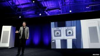 Tesla Motors CEO Elon Musk reveals a Tesla Energy battery for businesses and utility companies during an event in Hawthorne, California