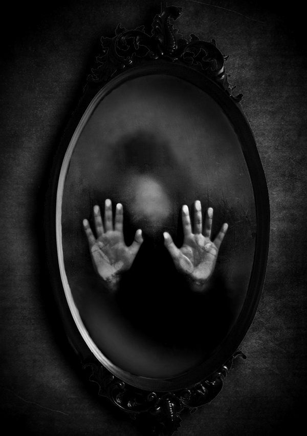 Mirror Image - There's a woman in the mirror who haunts me. She's not my reflection, but an entity all to herself. Something like me, but not quite me.