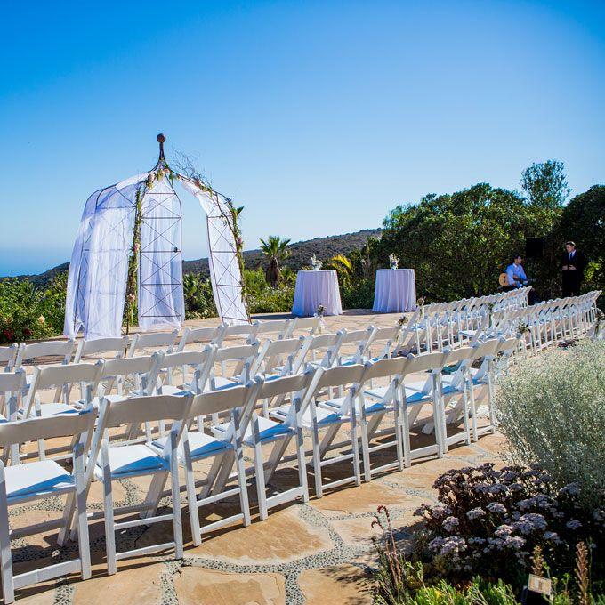 White, casual outdoor wedding ceremony in Malibu, California