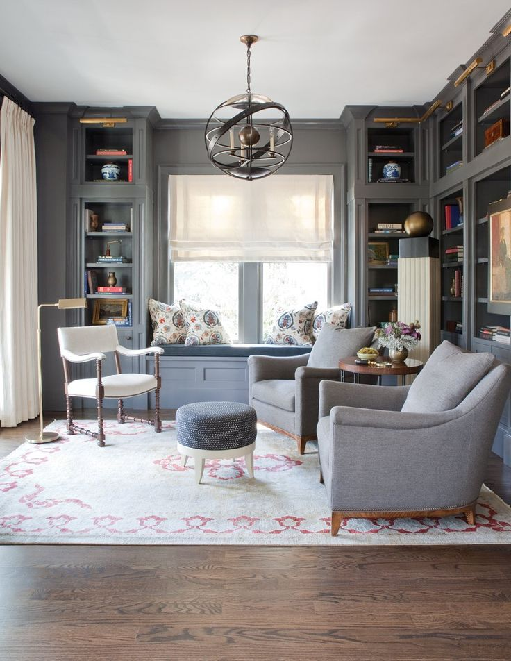 """Kendall Charcoal - Benjamin Moore  """"The dark color really envelops you and feels cozy,"""" says interior designer Nina Nash. When she and her Mathews Furniture partner Don Easterling created this sultry and sophisticated study in Ansley Park, they installed classic built-ins, then furnished the room in rich tones from both ends of the color spectrum"""
