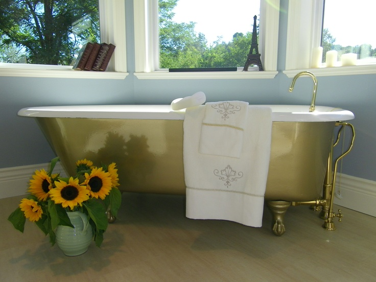 Cast iron antique bath tub painted gold and refinished.  By interior designer Jil Sonia McDonald of Reflections Interior Designs, client in Abbotsford, BC
