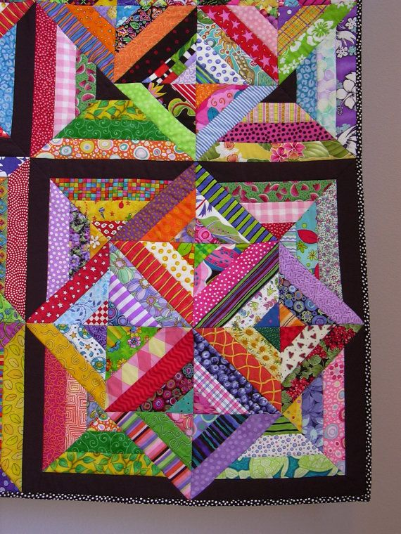 This quilt is based on the popular Bouillabaisse pattern, hence from where the title of my quilt comes. Using so many brightly colored fabrics makes this quilt a joy to look at. And the solid black framing causes a bit of an optical illusion, with some blocks appearing to come forward and others to recede. This quilt always gets raves when on display. It measures 60 square.  This quilt is included in six Etsy treasuries:  Colors Colors Colors  http://www.etsy.com/treasury/...
