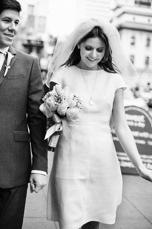 short valentino wedding gown, blusher veil, urban wedding, san francisco city hall, white bouquet. Photo: Christina McNeill